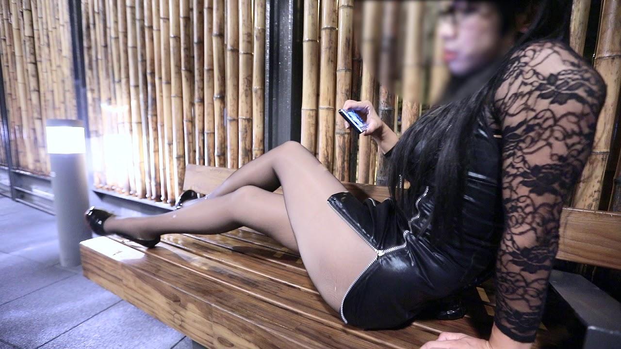 Crossdresser in old black nylons,mini dress, outdoor high