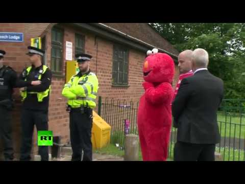 Theresa May met by Elmo as she votes in Maidenhead #GE2017