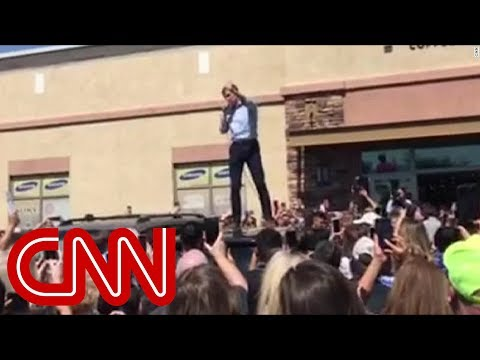 Beto O'Rourke campaigns from the top of a minivan