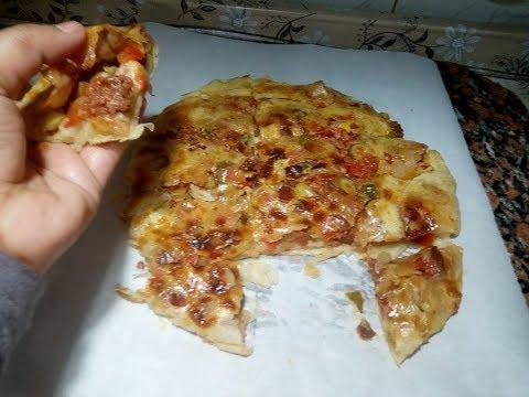 صورة  طريقة عمل البيتزا طريقة عمل البيتزا الشرقى نفس الطعم بتاع الفطاطرى (لفطير االحادق المحشو بالسجق ) طريقة عمل البيتزا من يوتيوب