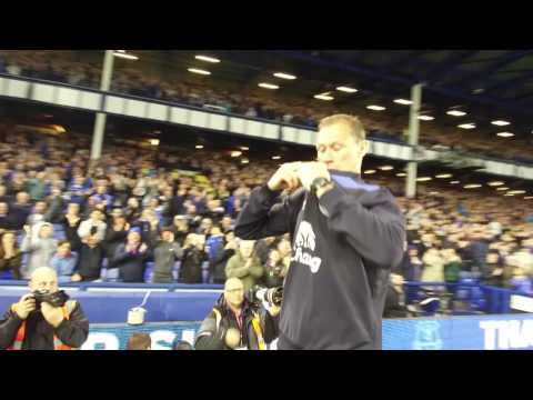 Duncan Ferguson throws his kit into the crowd