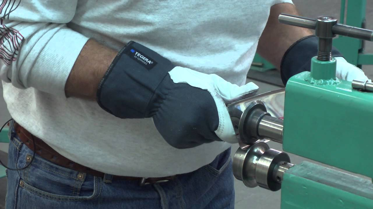Metal Shaping Stainless Steel Trim In The Bead Roller