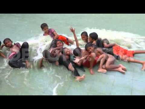 Child's enjoy in the hot summer weather in the city of Dhaka
