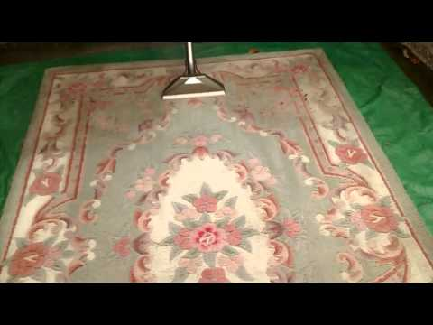 Chinese Wool Rug Being Extraction