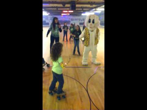 Easter bunny and kids dancing
