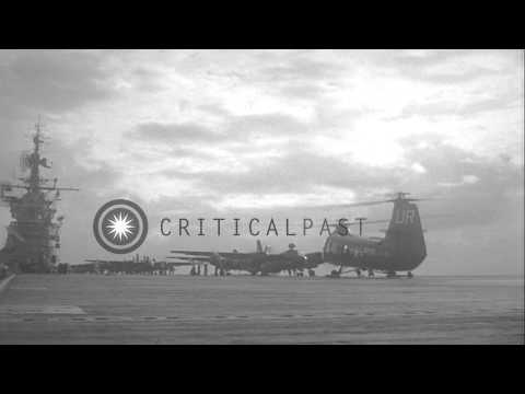 A US Grumman S2F tracker aircraft and a Piasecki HUP-2 helicopters take off from ...HD Stock Footage
