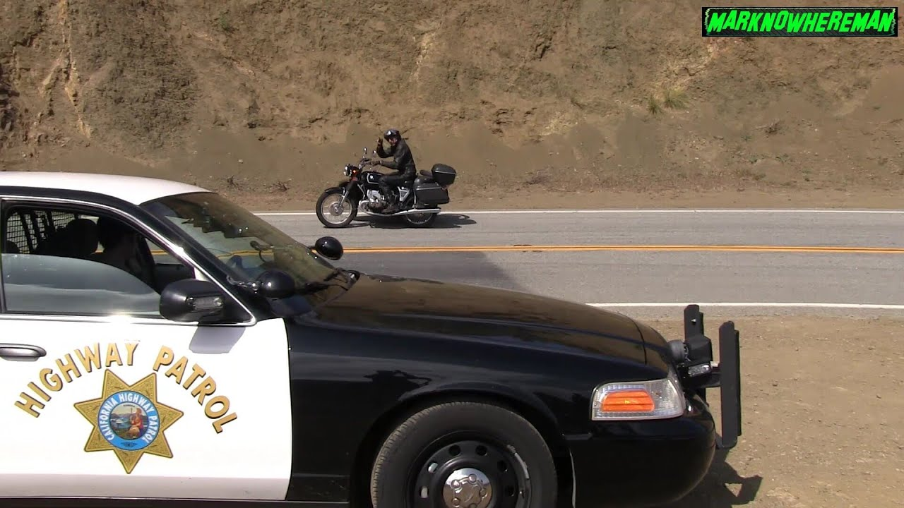 Motorcycle Side Wheelie Knee Dragging In Front Of A Cop