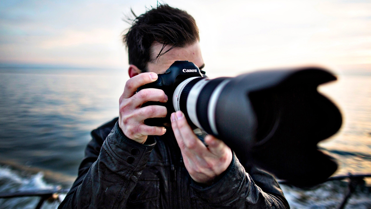 Photographer with long lens