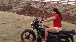 Wife Riding Bike on Beach