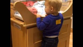 Watch this sister meet her newborn brother for the first time