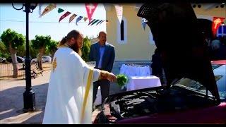 Priest blessing cars in Greek village