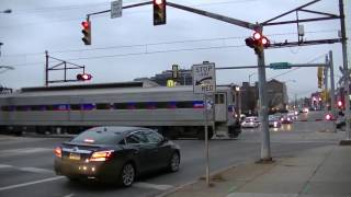 SEPTA commuter train creeps through crossing with old cantilvers