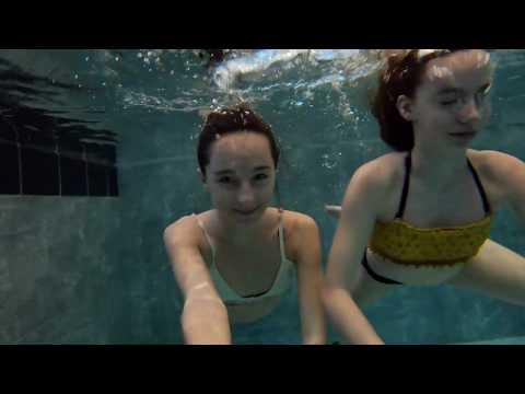 Carla underwater swimming with Lola underwater