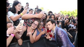 Harry Styles meets lucky fans on the Red Carpet