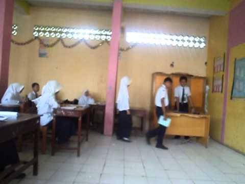 Tugas Aqidah VIIIA Husnuzan & Namimah MTs YMPI Rappang