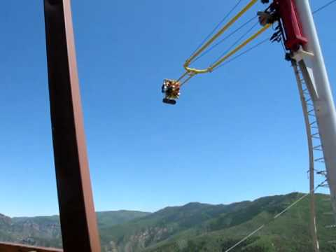 Amusement park swing ride over I-70 with awesome mountain view