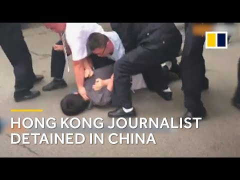 Hong Kong journalist handcuffed and dragged into police van in China