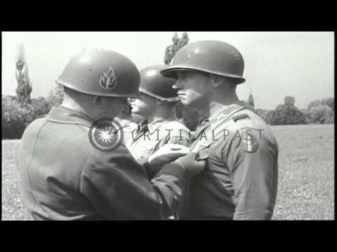 General Frederick M. Harris presents Silver Stars to men of 254th Infantry Regime...HD Stock Footage