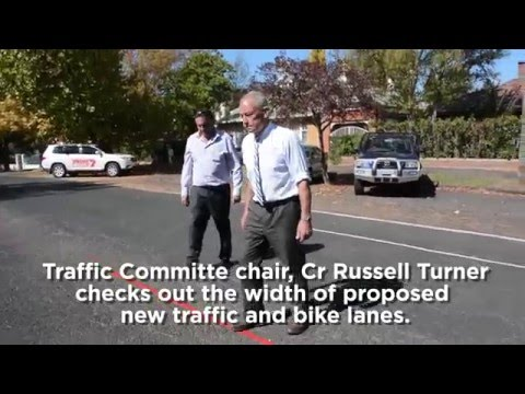 Orange City Council member, Russell Turner, checks out the width of proposed new bike and traffic lanes.