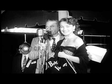 Peggy Dow and Arthur Kennedy sign autographs for people at the premiere of movie ...HD Stock Footage