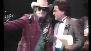 Texas Tornados Freddy Fender and Doug Sahm talking with Johnny