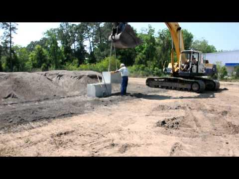 Installation of precast concrete blocks by Big Iron, Inc.AVI