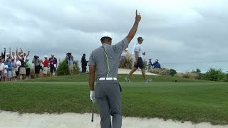 Tiger Woods holes out from the bunker at Hero World Challenge