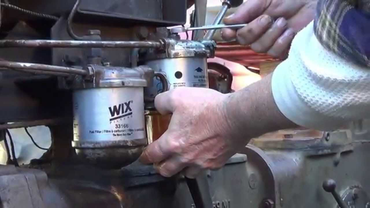 how to change fuel filters on the mf 35 diesel deluxe tractor [ 1280 x 720 Pixel ]