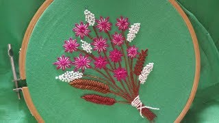 Hand embroidery of a flower bouquet with lazy daisy and bullion stitch