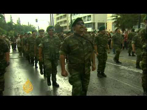 Protests greet Merkel in Greece