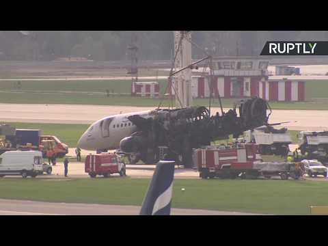 Live from Sheremetyevo: Emergency services remove crash-landed Aerflot airplane's remains