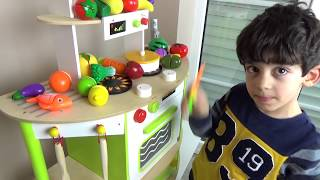 Jason Plays with Toy Kitchen