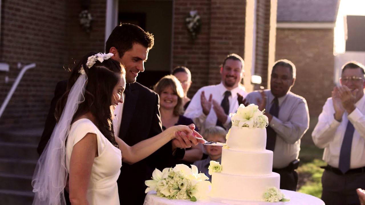Newlywed couple cutting their wedding cake    YouTube