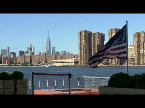 Manhattan Skyline with American Flag Wind - Copyright Free Stock Footage Video Clip