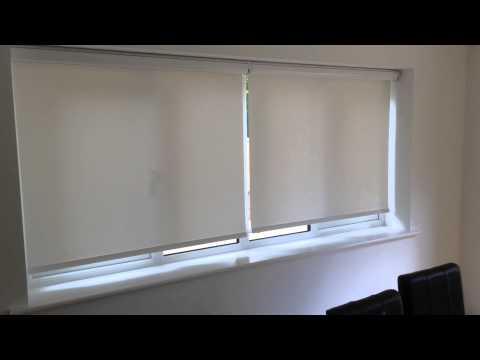 Louvolite one touch electric roller blinds