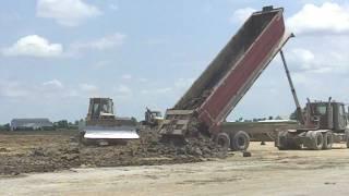 John Deere 700 H Dozer Leveling Dirt From 3 Dump Trucks