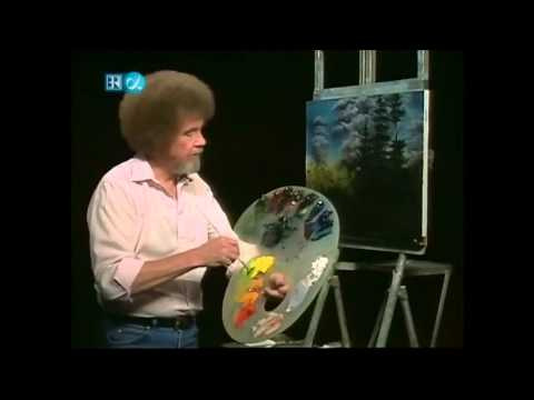 White guy with afro painting