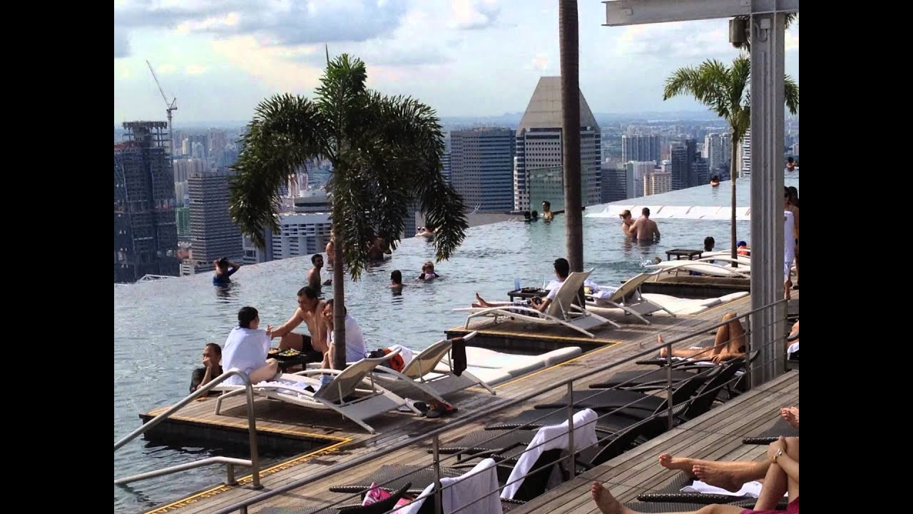 unendlich mbs pool relaxing by infinity pool skypark marina bay sands mbs singapore entersingaporeinfo