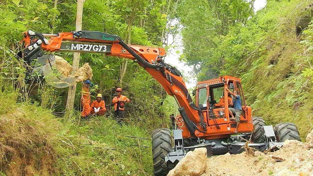 spider excavator clearing landslide