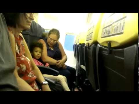 Watch woman fights kid over seat-belt during landing in Shannon airport