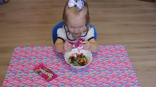 "Learn Colors when playing with candy ""Skittles"". Cheerful experiment under children's songs."