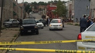 Baltimore police chase ends in crash with vacant row house, 2 arrests