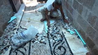 Traditional Greek pebblestone mosaic artist Stelios Grekos at work
