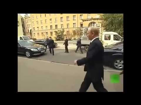 President Vladimir Putin walks alone in the streets of St. Petersburg in the Russian