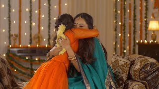Cute little daughter showing love for her beautiful mother - South Indian Family