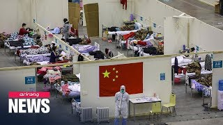 New coronavirus cases in China drop below 1,000 for first time