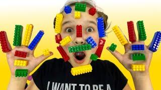 Toys gets stuck on Niki's face   LEGO HANDS   Emi and Niki Family Show