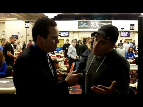 Kirk Acevedo talks to Matt Savage at break of the $1,000,000 GTD