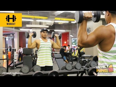 How To Perform A Standing Dumbbell Shoulder Press | Workout Guide