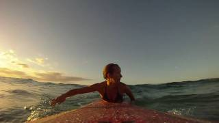 Sunset surfer girl Daize Shayne Goodwin and a GoPro HD